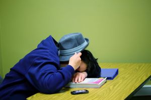 photo of student sleeping on a book